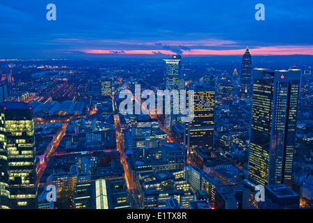 Sunset over the Messeturm, Westendstrasse 1, and Trianon skyscrapers and the City of Frankfurt am Main, Hessen, - Stock Photo