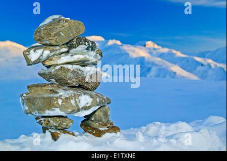 Inukshuk, rock landmark, icon, Alaska, Arctic, Winter - Stock Photo