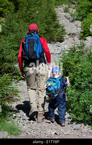 Father and Son Hiking up the trail to Dinky Peak, Mount Seymour Provincial Park, British Columbia, Canada - Stock Photo