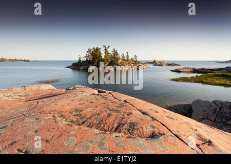 Pink granite islands in Georgian Bay on Lake Huron as seen the Chikanishing Trail in Killarney Provincial Park Ontario - Stock Photo