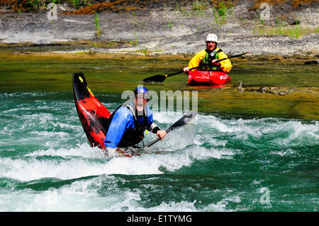 A kayaker caught in an eddy near Horseshoe Bend on the Cowichan River near Lake Cowichan, BC. - Stock Photo