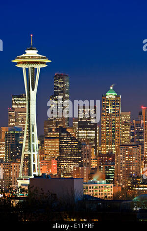 Illuminated skyline of Seattle in Washington State, USA at twilight on a cold winter day - Stock Photo