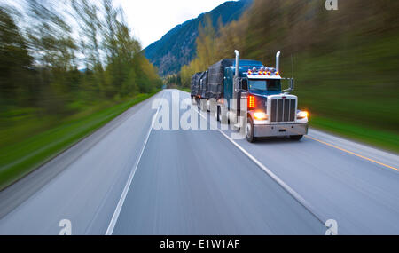 Transport truck on the road south of Hope. - Stock Photo