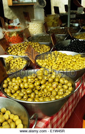 A market stall in Pollenca Mallorca selling green olives - Stock Photo