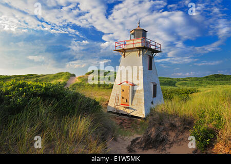 Lighthouse in sand dunes, St Peters Harbour, Prince Edward Island, Canada - Stock Photo