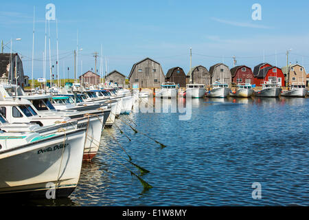 Fishing boats tied up at Malpeque Harbour wharf, Prince Edward Island, Canada - Stock Photo
