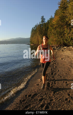 Running the Admirality Trail in Belcarra Regional Park. Port Moody, British Columbia, Canada - Stock Photo