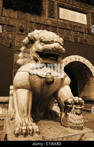 The stone lion statue in front of Chinese temple - Stock Photo