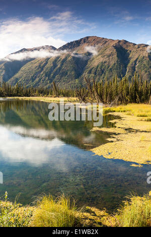Mountain reflections on the Mentasta Lake road off the Tok Cutoff of the Glenn Highway in Alaska, United States - Stock Photo