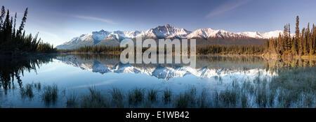 Reflected snow dusted mountains in the Kluane Range the St. Elias Mountains south Beaver Creek Yukon along the Alaska - Stock Photo