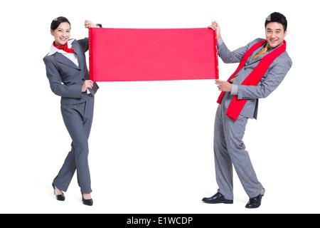Happy business people celebrating Chinese New Year - Stock Photo