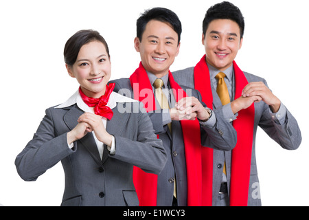 Cheerful business people offering traditional Chinese New Year greeting - Stock Photo