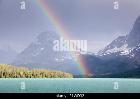 A rainbow over Bow Lake in Banff National Park, Alberta, Canada - Stock Photo