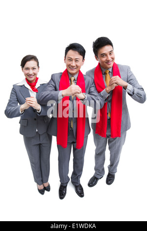 Happy business people offering traditional Chinese New Year greeting - Stock Photo