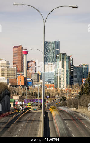 Light trails from cars driving to and from downtown Calgary in Alberta, Canada. - Stock Photo