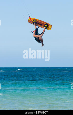 A kiteboarder is inverted on a relatively calm day, Las Terrenas, Dominican Republic - Stock Photo