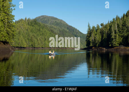 Yachter in small inflatable, Nimmo Bay Wilderness Resort, British Columbia, Canada - Stock Photo
