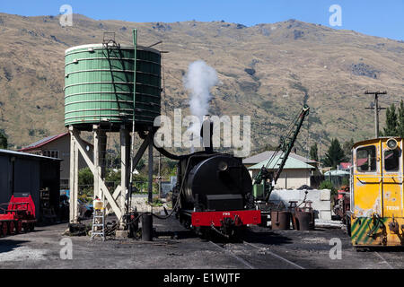 Loading water into a steam engine for the Kingston Flyer in Kingston, New Zealand - Stock Photo
