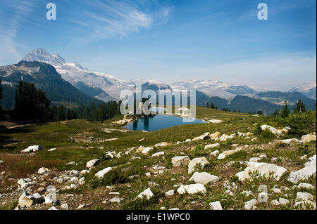 Elfin lakes on a sunny day, with the cabin/shelter by the far edge of the lake. - Stock Photo