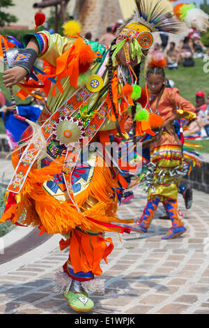 First Nations dancers in traditional dress at a pow wow ceremony, Winnipeg, Manitoba, Canada - Stock Photo