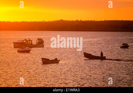 Oyster fisherman stting out at sunrise, West River Causeway, Prince Edward Island, Canada - Stock Photo