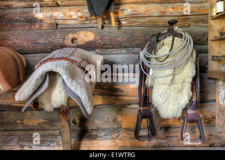 Saddle and blankets in a horse barn, Bar U Ranch National Historic Site, Alberta, Canada - Stock Photo