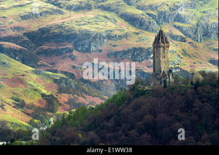 National Wallace Monument standing on a hill overlooking Stirling Castle in Scotland - Stock Photo