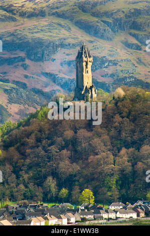 National Wallace Monument standing on a hill overlooking a village near Stirling Castle in Scotland, UK - Stock Photo