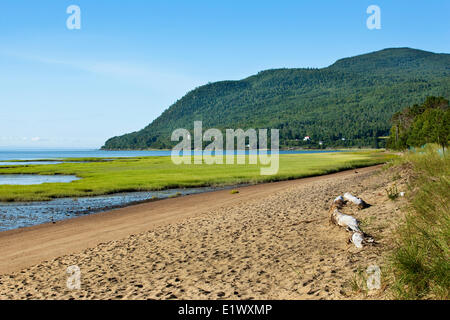 Baie-Saint-Paul beach overlooking the St. Lawrence River. In the background is the beginning the mountain range - Stock Photo