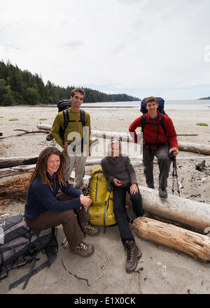Four friends pose for a photo before embarking on their West Coast Trail adventure. Bamfield Vancouver Island British - Stock Photo
