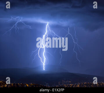 Lightning during a thunderstorm over the city of Cochabamba, Bolivia. - Stock Photo