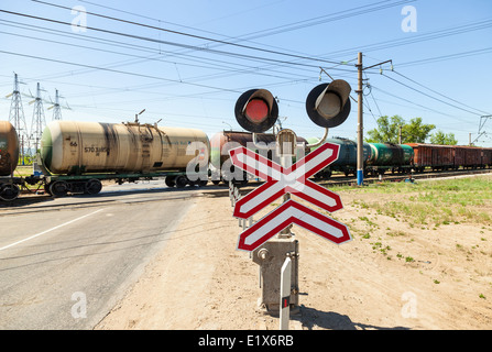 Cargo train riding over a railway crossing - Stock Photo