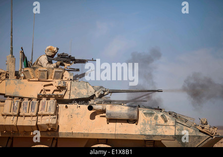 A US Marine Corps light armored vehicle assigned to the 22nd Marine Expeditionary Unit opens fire during a live - Stock Photo