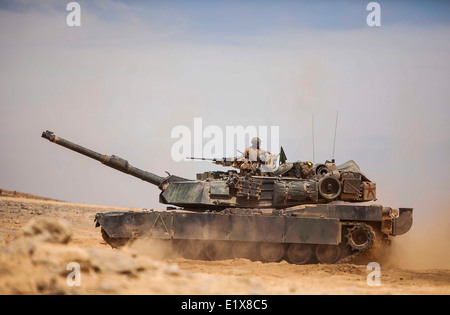 A US Marine Corps M1A1 Abrams battle tank assigned to the 22nd Marine Expeditionary Unit repositions during a live - Stock Photo