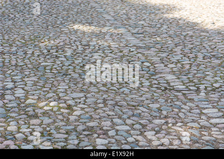 Background of an old cobble stone pavement with line pattern - Stock Photo