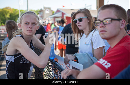 High school athletes compete in a track and filed meet in Milwaukee, Wisconsin, USA. - Stock Photo