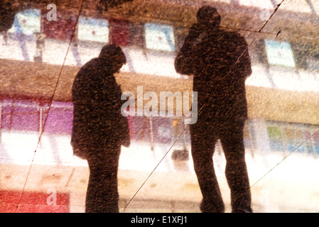 Businessman silhouette in modern business interior. Businesspeople in action. - Stock Photo