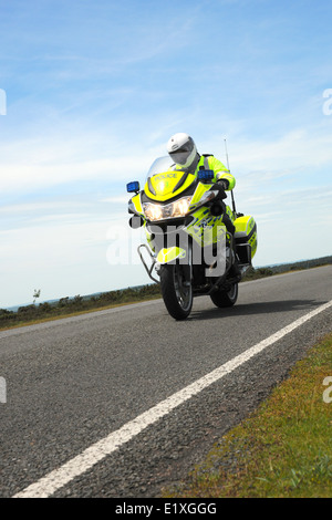 A police motorcyclist on a BMW R1200RT motorcycle against  able sky and clouds. England. June 2014. - Stock Photo