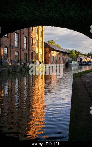 Blisworth Corn Mill and narrowboats on the Grand Union Canal at sunrise. Blisworth, Northamptonshire, England - Stock Photo
