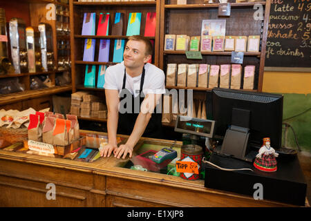 Portrait of confident salesperson in coffee store - Stock Photo