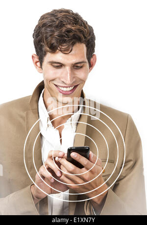 Smiling young businessman using cell phone over white background