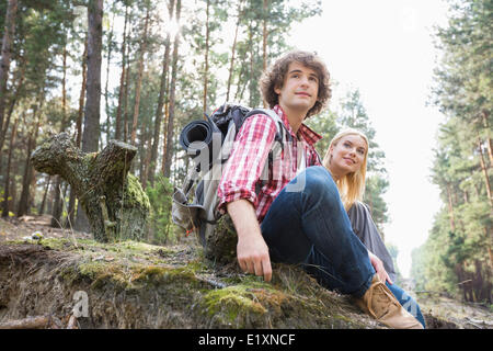 Young hiking couple relaxing in forest - Stock Photo