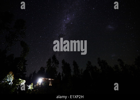 milky way and stars in the sky over woods in los pellines chile - Stock Photo
