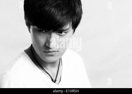 Young man posing and looking cool - Stock Photo
