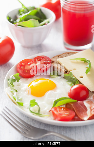 fried egg ham tomatoes for healthy breakfast - Stock Photo