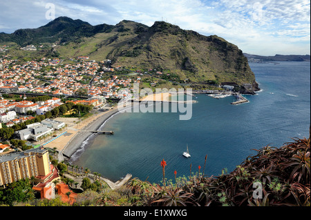 Madeira Portugal. Looking down on the coastal city of Machico - Stock Photo