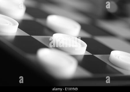 Focus on white checker - Stock Photo