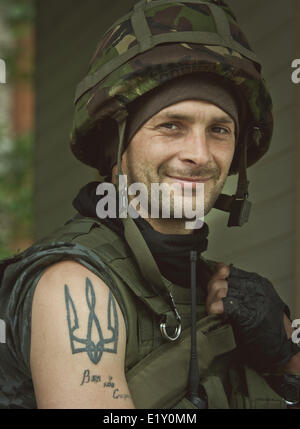 Donbas, Donetsk, Ukraine. 10th June, 2014. National Guard soldier with trident - Ukrainian national symbol - tattoo - Stock Photo