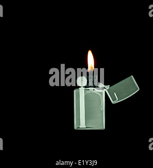 X-ray image of a Zippo lighter - Stock Photo