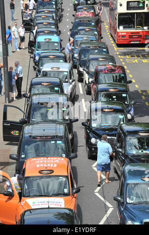 Embankment, London, UK. 11th June 2014. Taxis fill the streets and bring the center of London to a standstill. Credit: - Stock Photo